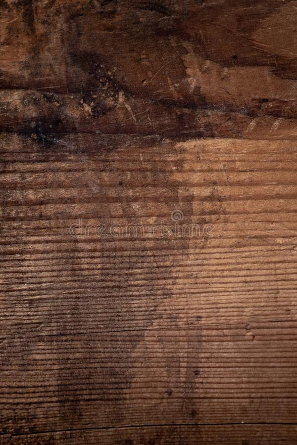 Wood texture, Dark Brown scratched wooden cutting board. Natural stock image