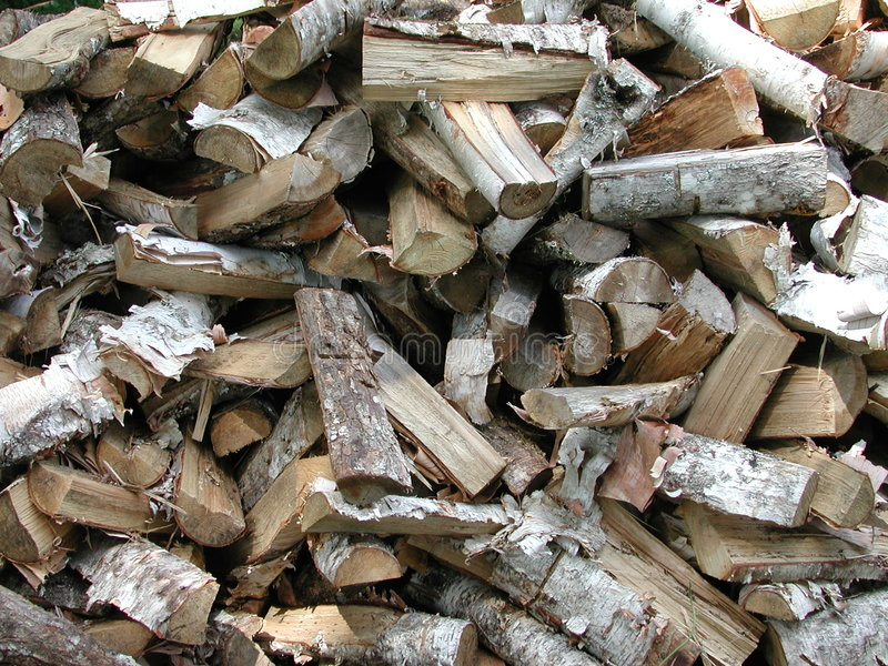 Wood Texture Firewood Pattern. A pile of firewood, ready for a campfire or woodstove in a pattern stock images