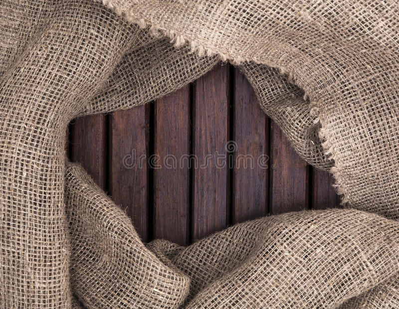 Wood texture. Frame textiles. Frame of wood. Grunge dark wood texture and textile texture. burlap royalty free stock photos