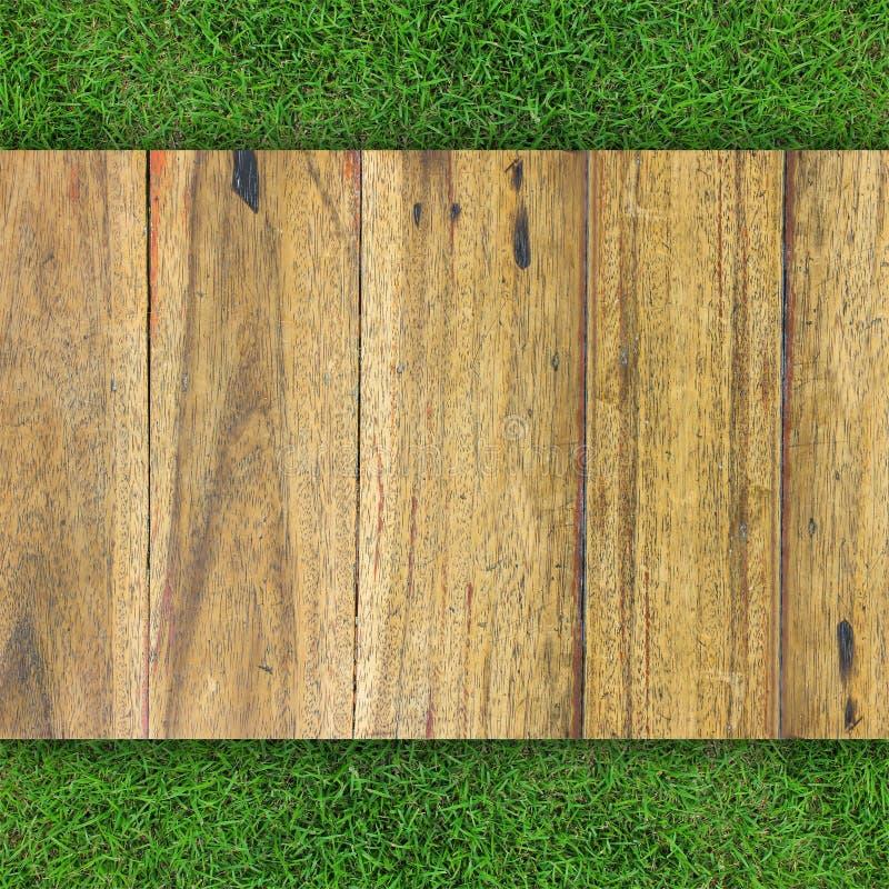 Wood texture on grass stock illustration