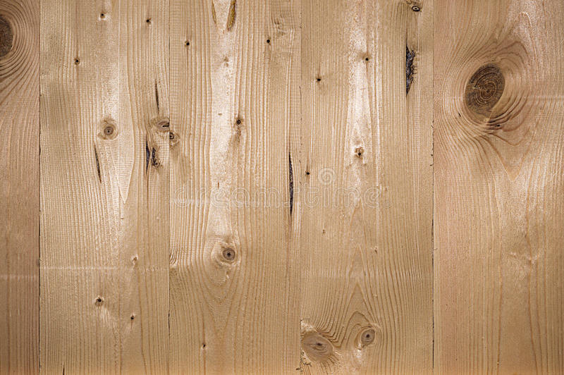 Wood texture with natural pine pattern. The texture of natural pine boards planed. Boards are arranged vertically stock photography