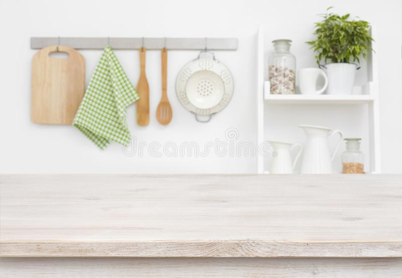 Wood texture table over blurry kitchen wall and shelf background royalty free stock image