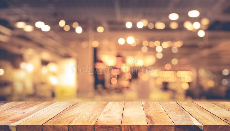 Wood texture table top counter bar with blur light gold bokeh in cafe,restaurant background.For montage product display or. Design key visual layou royalty free stock photography