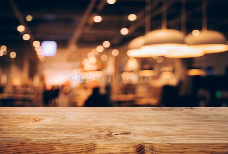Wood texture table top counter bar with blur light gold bokeh in cafe,restaurant background.For montage product display or. Design key visual layou stock images