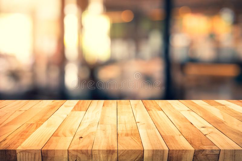 Wood texture table top counter bar with blur light gold bokeh in cafe,restaurant background. For montage product display or design key visual layout royalty free stock images