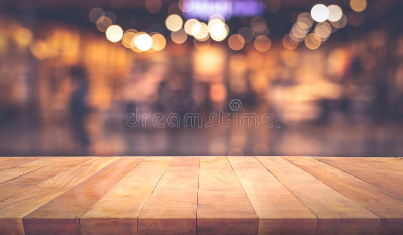 Wood texture table top counter bar with blur light gold bokeh in cafe,restaurant background. For montage product display or design key visual layout royalty free stock photography