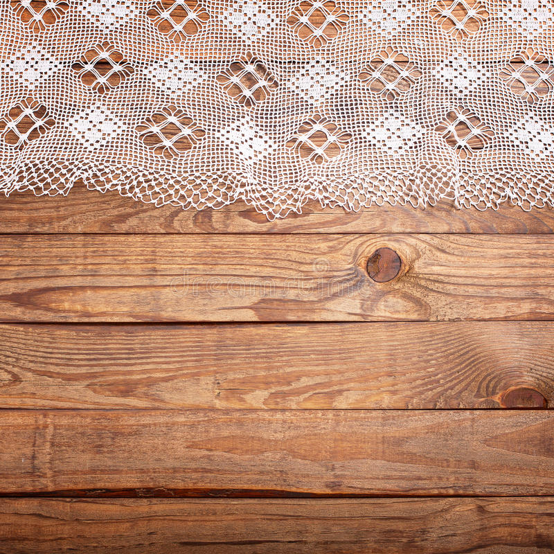 Wood texture wooden table with white lace tablecloth top