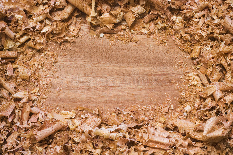 Wood textured background with shavings. Wood textured background with wood shavings made into a frame. Add something in the middle