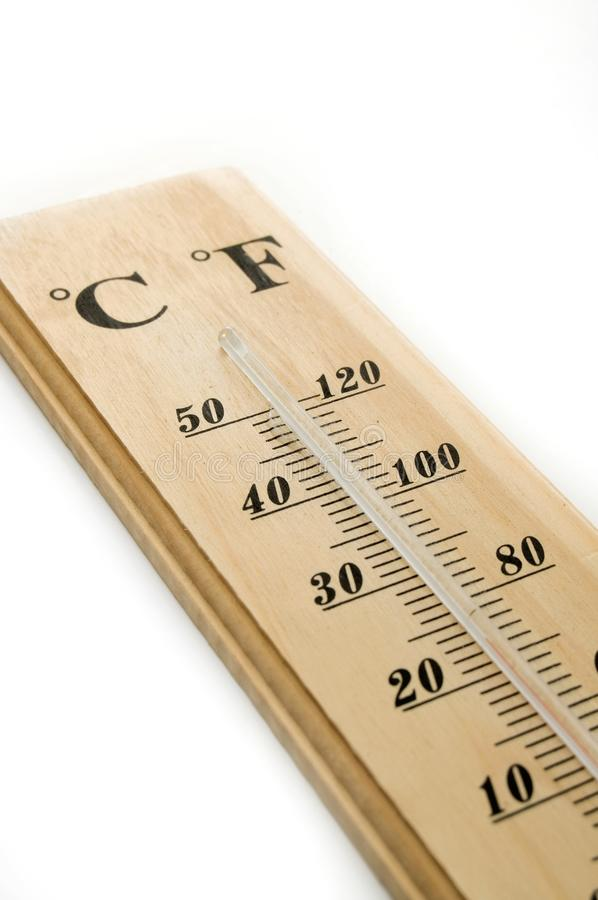 Wood Thermometer on white. Wood Thermometer with Celcius and Fahrenheit on white royalty free stock photo