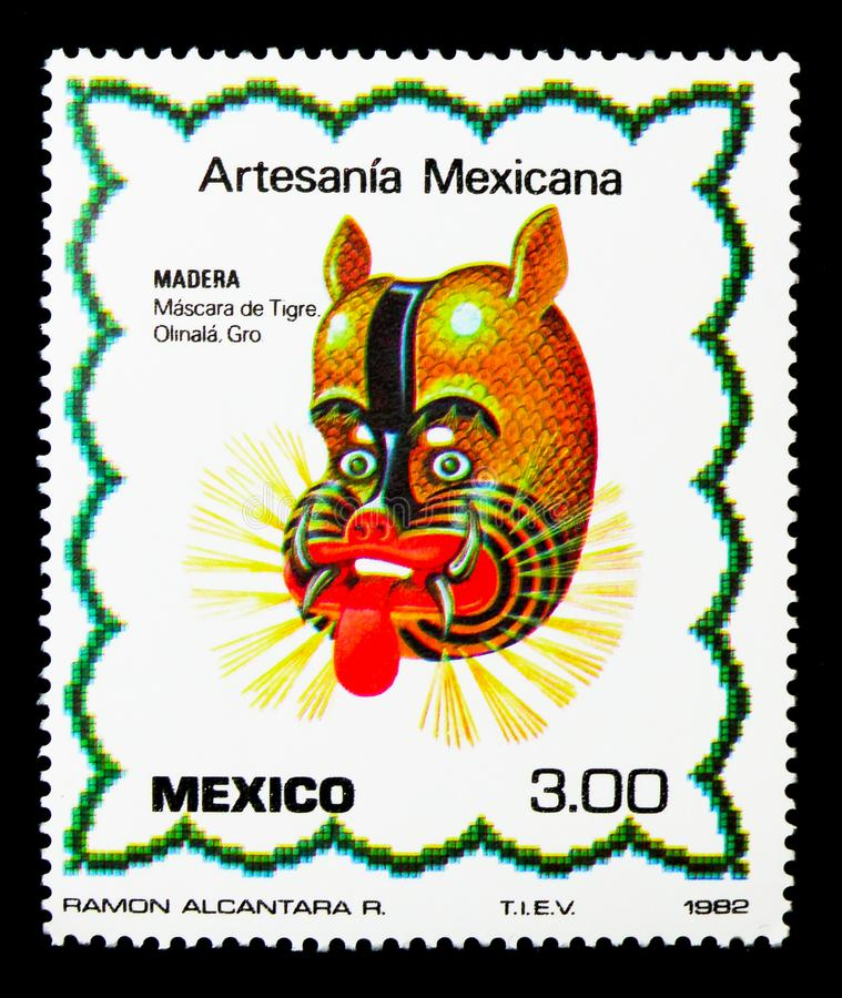 Wood - Tiger Mask, Artesania Mexicana - 2a serie, circa 1982. MOSCOW, RUSSIA - NOVEMBER 25, 2017: A stamp printed in Mexico shows Wood - Tiger Mask, Artesania royalty free stock images