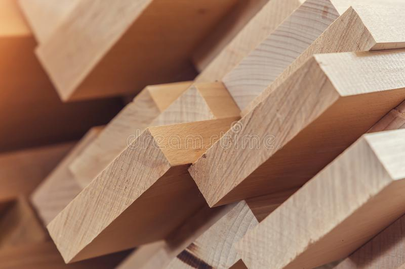 Wood timber construction material for background and texture. close up. Stack of wooden bars. small depth of field. Wood timber construction material for royalty free stock images