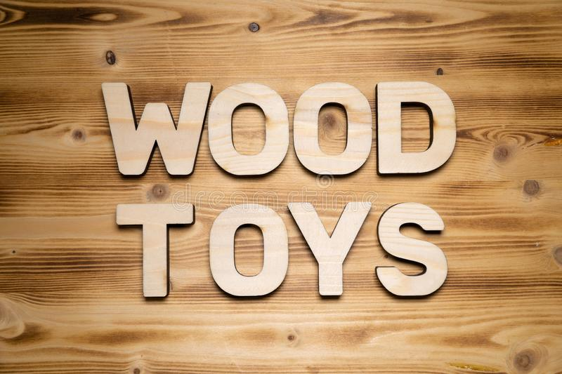 WOOD TOYS words made of wooden block letters on wooden board royalty free stock photo