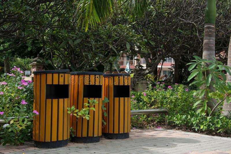 Wood trash bin in the garden royalty free stock images
