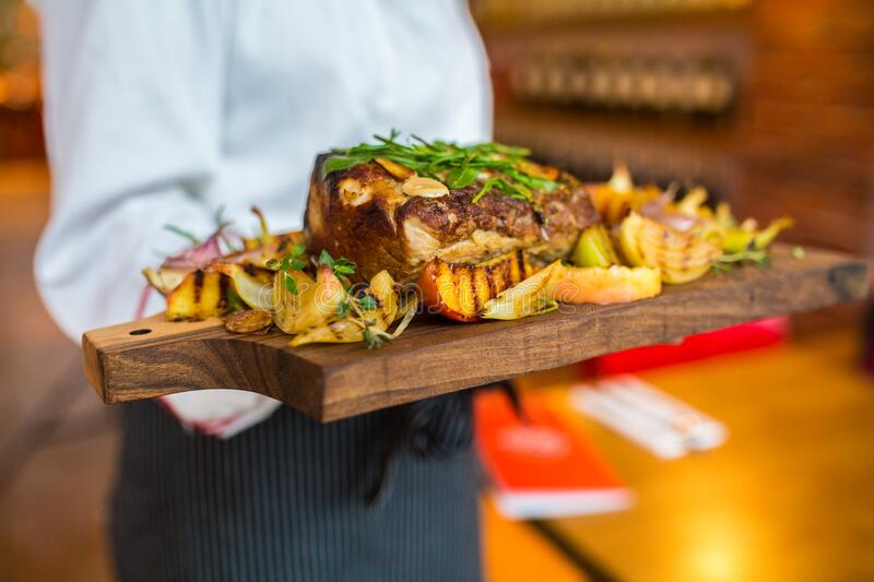 Wood tray with roasted meat stock images