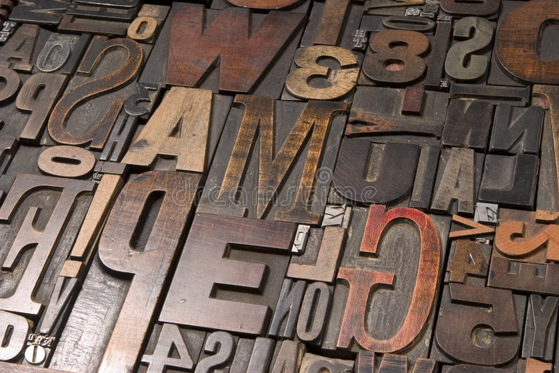 Wood type 2. An assortment of old wooden and metal type blocks royalty free stock photography
