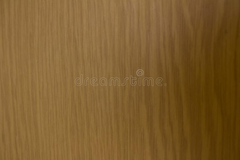 Wood under varnish. Lacquered wood. The texture of the tree.  stock photo