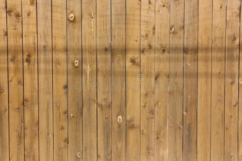 Wood vertical brown texture, wood background with knots royalty free stock images