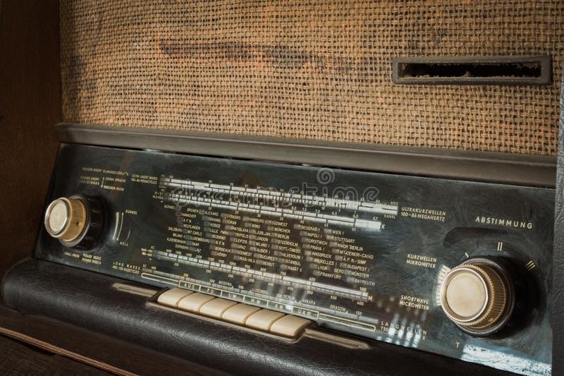 Wood vintage antique analog radio with radio dial on wooden table. stock images