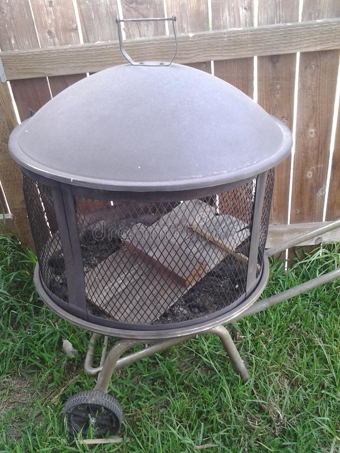 Wood waiting to become ash. A fire pit with it's next victim stock images