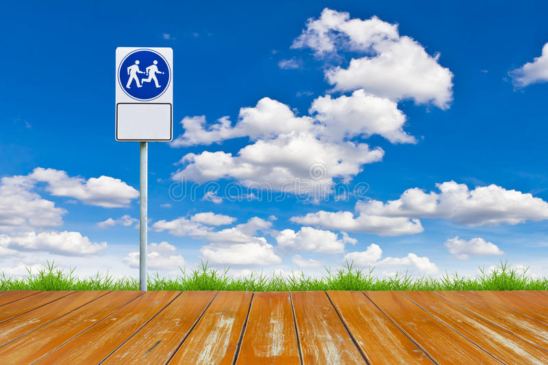 Wood walk way and sign. Against blue sky royalty free stock photos