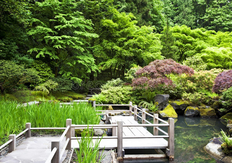 Wood walkway. Over pond at the Japanese Gardens in Portland, Oregon stock image