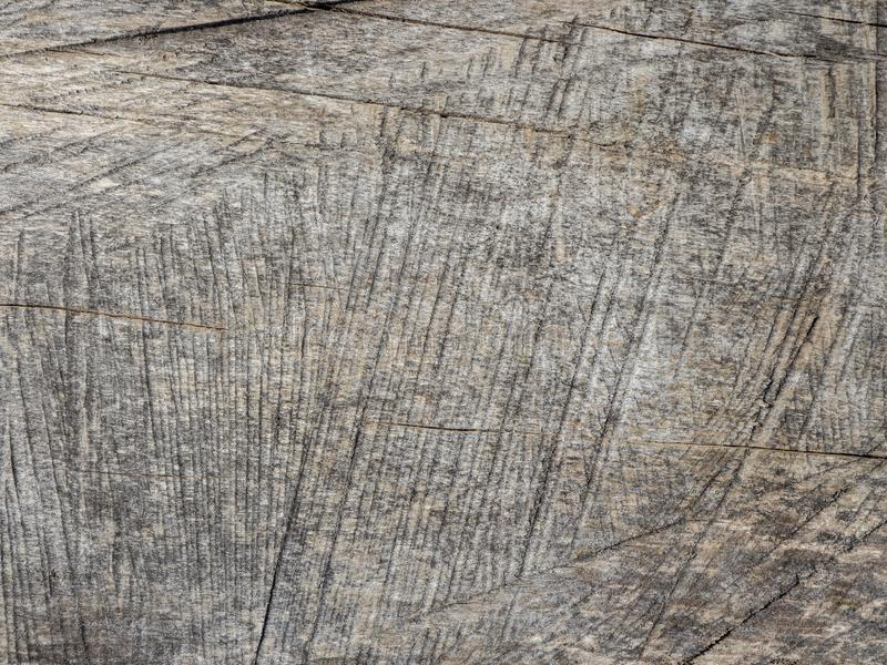 Wood background texture. Wood wall covered in line scratches. Wood wall covered in line scratches. It seems that the wood wall was scratched by someone into stock photography