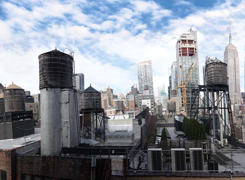 Watertowers New York City buildings midtown Empire State building. Wood water towers in midtown manhattan new york empire state building stock photo