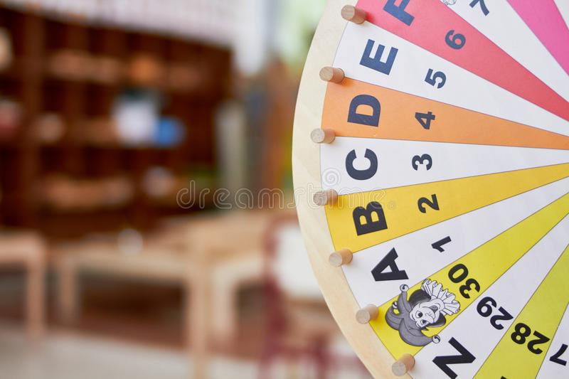Wood wheel learning letters and numbers. With colors royalty free stock images