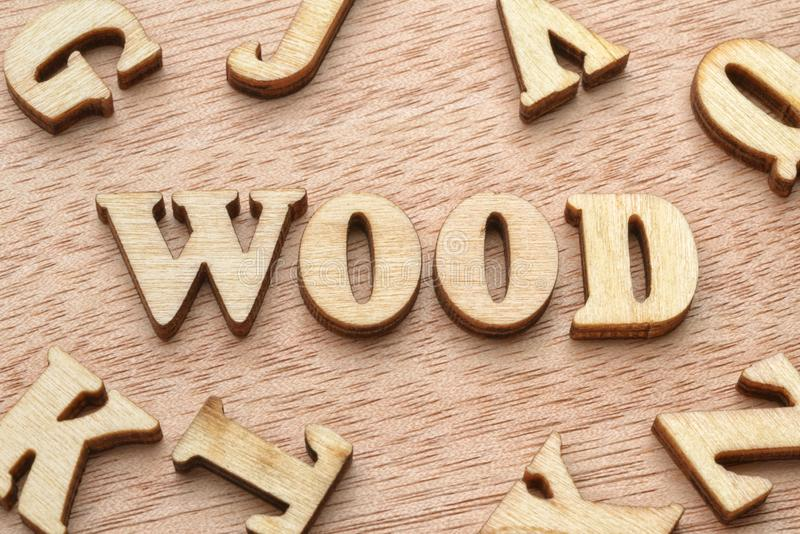 Wood word wooden letters. Wood word made with wooden letters. Natural material or fuel concept royalty free stock photography