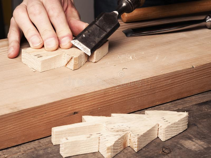 Wood working with a chisel royalty free stock image