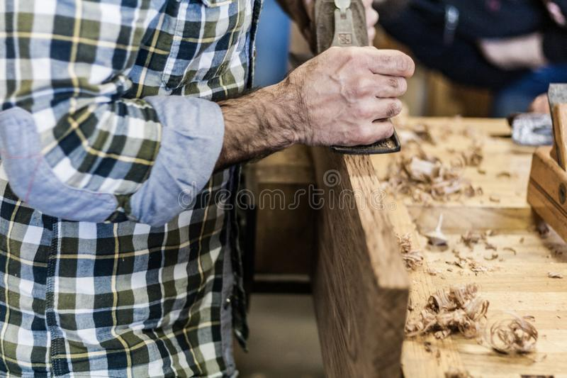 Woodworking art, an honest occupation within a sustainable lifestyle. Carpentry and cutting. stock image