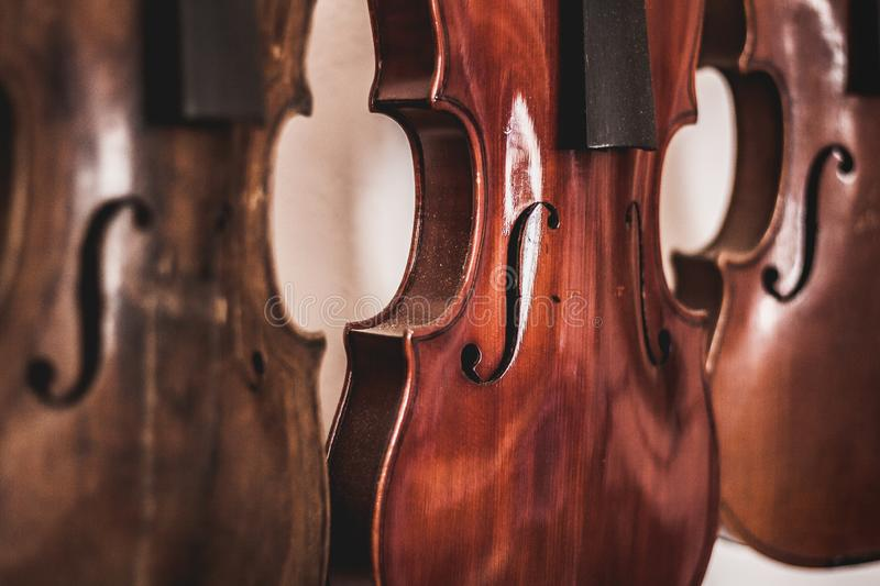 Woodworking art, musical intruments and violins made of oak wood royalty free stock photography