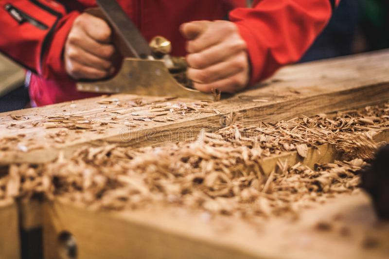 Woodworking art, an honest occupation within a sustainable lifestyle. Carpentry and cutting. stock images