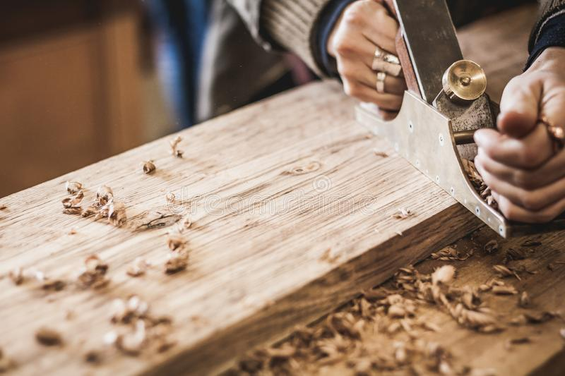 Woodworking art, an honest occupation within a sustainable lifestyle. Carpentry and cutting. Focus on planer. stock image