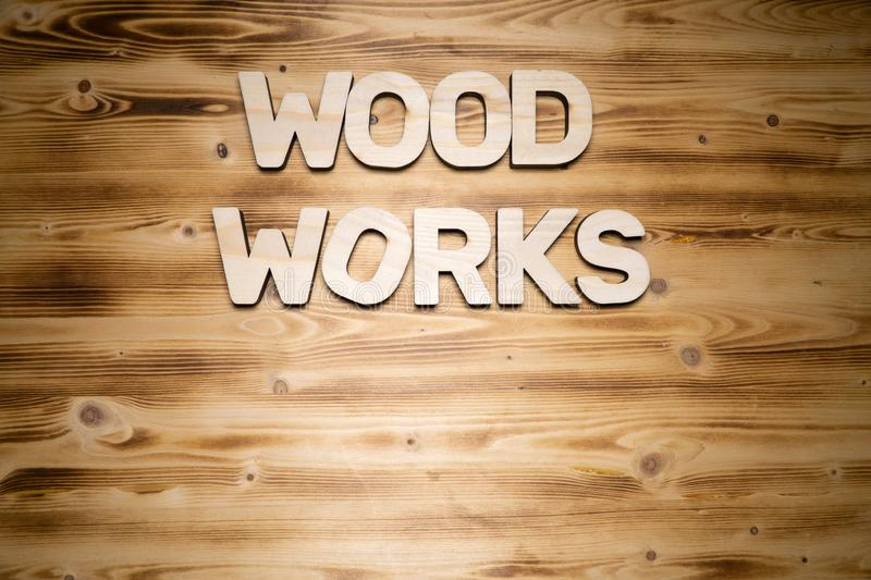 WOOD WORKS words made of wooden block letters on wooden board royalty free stock images