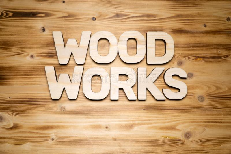 WOOD WORKS words made of wooden letters on wooden board stock photo