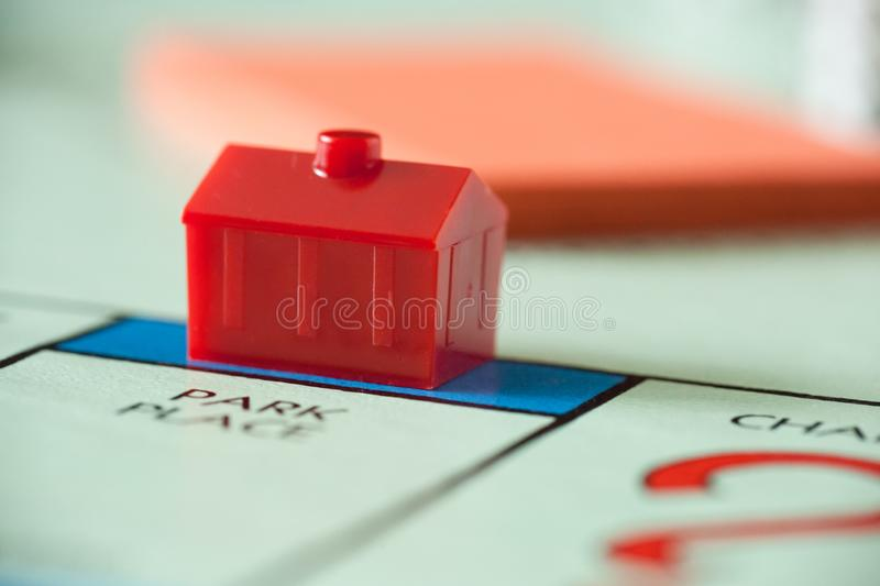 Monopoly Board Game Details. WOODBRIDGE, NEW JERSEY - October 11, 2018: A closeup view of a hotel property on a Monopoly board game, circa 1980s royalty free stock image