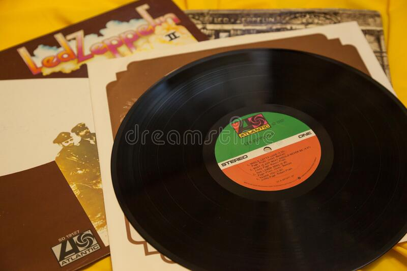 Vintage Led Zeppelin 33 RPM Record Album. WOODBRIDGE, NEW JERSEY / UNITED STATES - January 16, 2020: A pile of vintage Led Zeppelin albums on a bright yellow stock photo