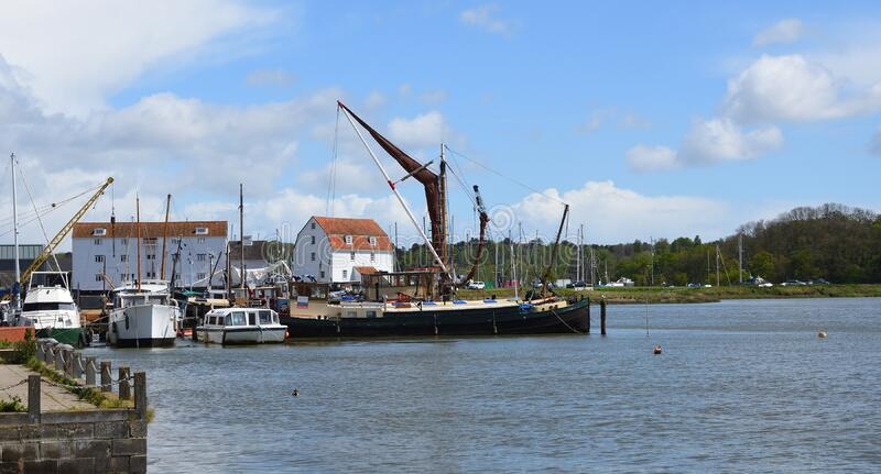 River Deben at Woodbridge with Tide Mill and Sailing Barge. WOODBRIDGE, SUFFOLK, ENGLAND - MAY 04, 2019: River Deben at Woodbridge with Tide Mill and Sailing stock photography