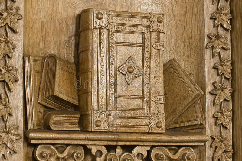 Woodcarving of the Bible. Detail of a beautiful pulpit, 17th. century handcrafted. Oak-wood royalty free stock photos