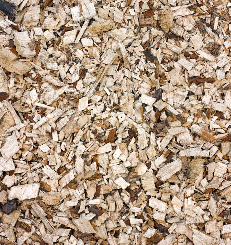 Woodchips background. Heap of dirty woodchips with bark natural background stock images