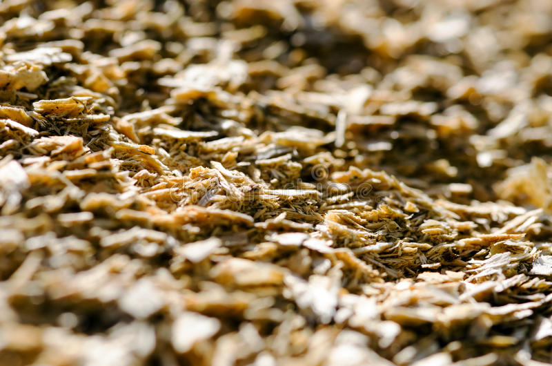 Woodchips. Detail of a pile of shredded wood stock image