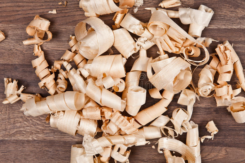 Woodchips (shavings) on wooden surface. Photo of woodchips (shavings) on wooden surface stock photography