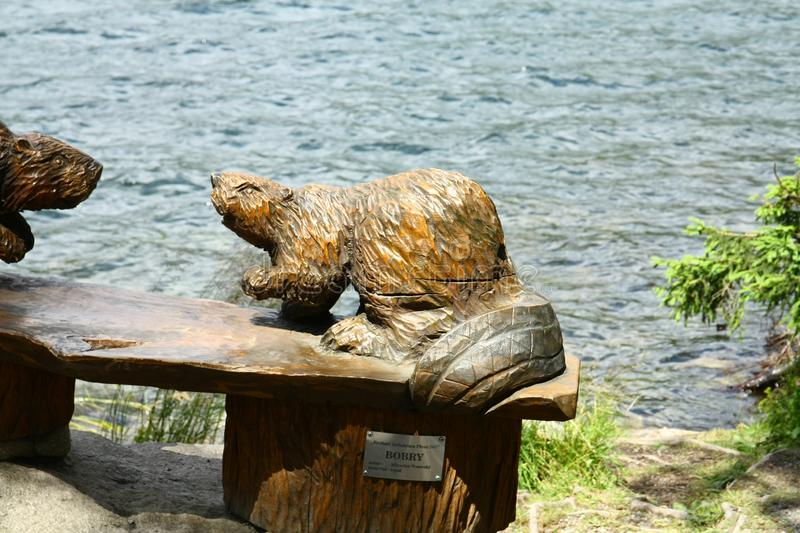 Woodcutting Beavers. Carved beavers from wood at the lake Strbske pleso royalty free stock photo