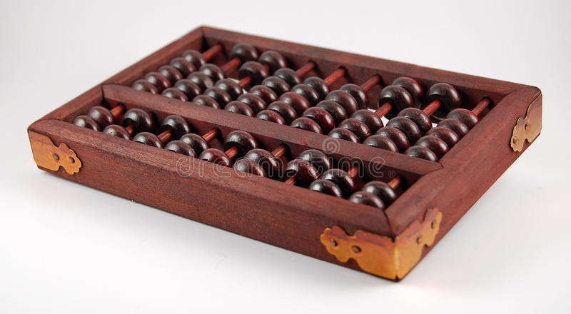 Wooden abacus metal corners. Small wooden abacus with bronze metal corners stock image