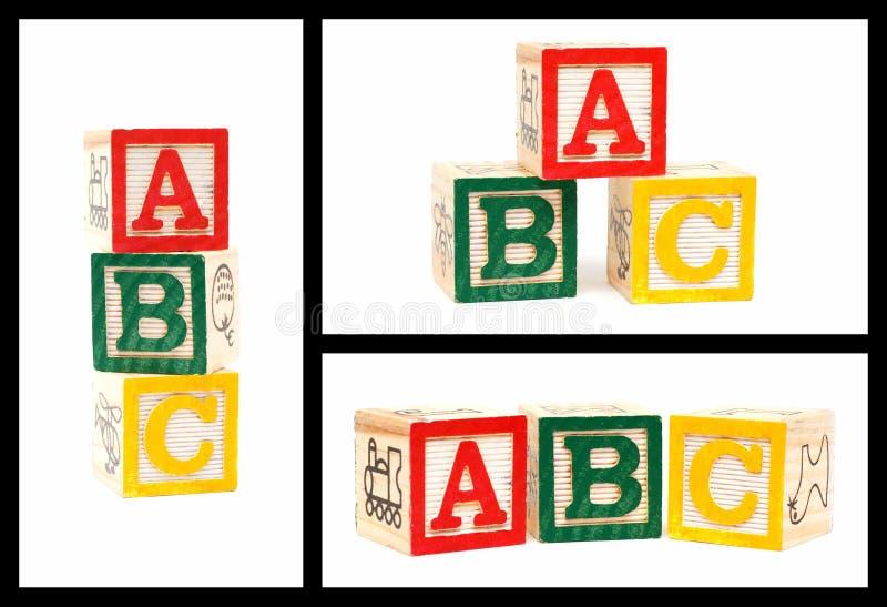 Wooden ABC blocks isolated on white background stock images