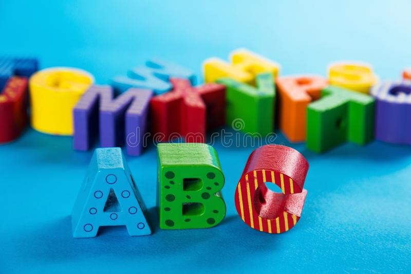 Wooden ABC Letters Standing. Alphabet letters wooden close-up educational toys preschool toy royalty free stock photo