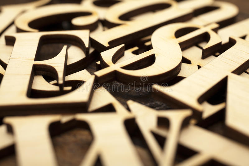 Wooden alphabet letters. On old wooden surface royalty free stock photography