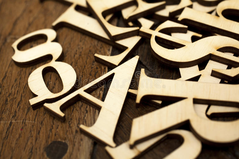 Wooden alphabet letters. On old wooden surface royalty free stock images