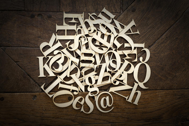 Wooden alphabet letters. On old wooden surface royalty free stock image